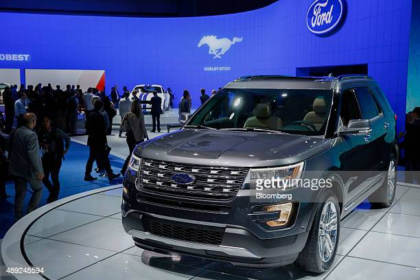 Members of the media view the Ford Motor Co Explorer limited edition sports utility vehicle during the Los Angeles Auto Show in Los Angeles...