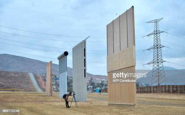 Members of the media visit prototypes of US President Donald Trump's proposed border wall on November 1 2017 in San Diego California The concrete and...