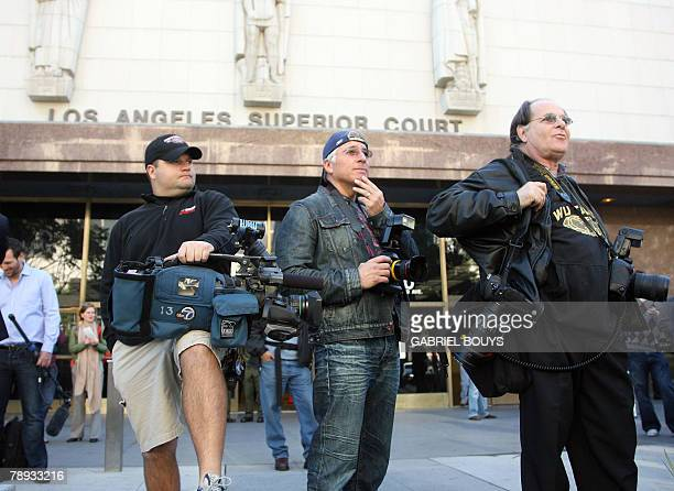 Members of the media wait for Britney Spears to arrive at the Los Angeles County Superior courthouse 14 January 2007 for a hearing regarding...