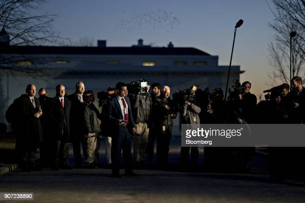 Members of the media wait for Mick Mulvaney director of the Office of Management and Budget not pictured to finish a television interview outside the...