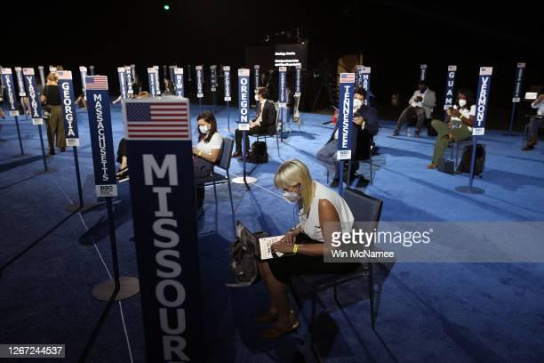 Members of the media wait for presumptive Democratic Vice Presidential nominee U.S. Sen. Kamala Harris to speak on the third night of the Democratic...