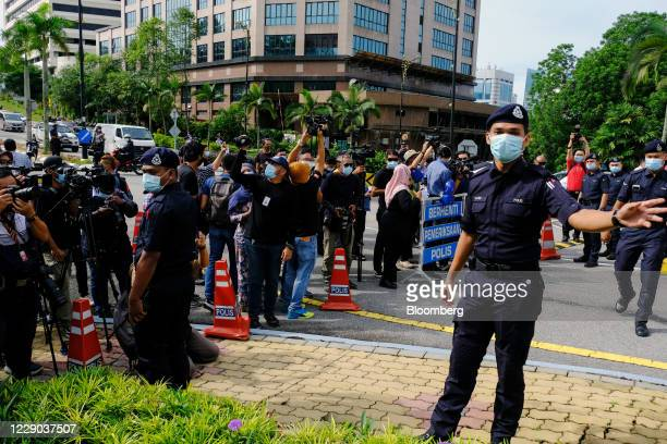 Members of the media wait for the arrival of Anwar Ibrahim founder and president of the People's Justice Party at the Istana Negara palace in Kuala...