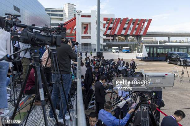 Members of the media wait for the arrival of Chinese President Xi Jinping at Macau International Airport in Macau, China, on Wednesday, Dec. 18,...