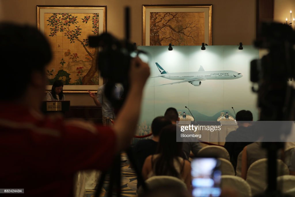 Members of the media wait for the Cathay Pacific Airways Ltd. news conference to begin in Hong Kong, China, on Wednesday, Aug. 16, 2017. Cathay Pacific is slipping in its efforts to get passengers to pay more for its premium services in a test for new Chief Executive Officer Rupert Hogg as the company reported back-to-back losses. Photographer: Paul Yeung/Bloomberg via Getty Images