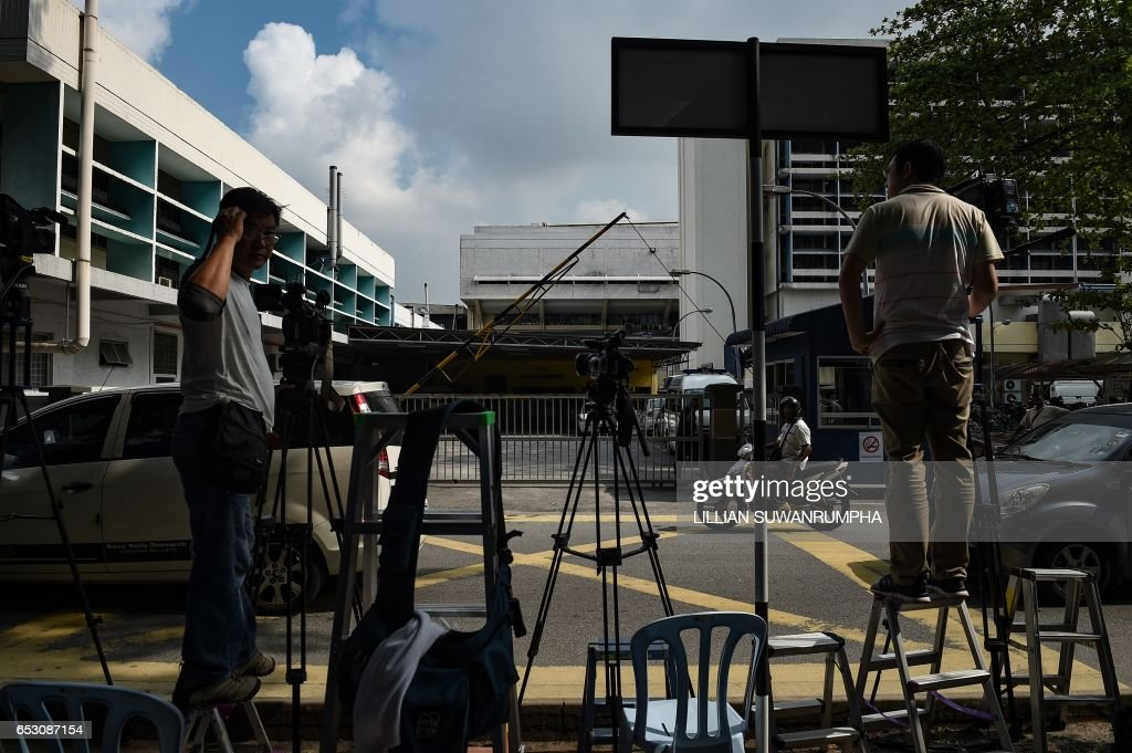 Members of the media wait opposite the gate of the forensics wing of the Hospital Kuala Lumpur, where the body of Kim Jong-Nam is being held, in Kuala Lumpur on March 14, 2017. The killing of the half-brother of North Korea's leader Kim Jong-Un last month in Kuala Lumpur International Airport with VX nerve agent triggered a bitter standoff between the previously friendly Asian nations, which have expelled each other's ambassador and refused to let their citizens leave. /