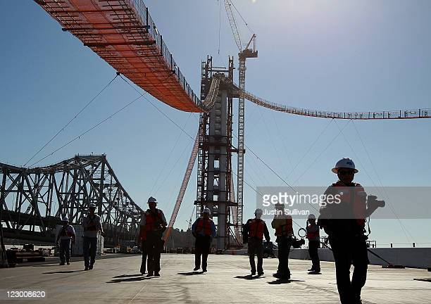 Members of the media walk on the deck of the newly constructed eastern span of the San FranciscoOakland Bay Bridge during a media tour of the...