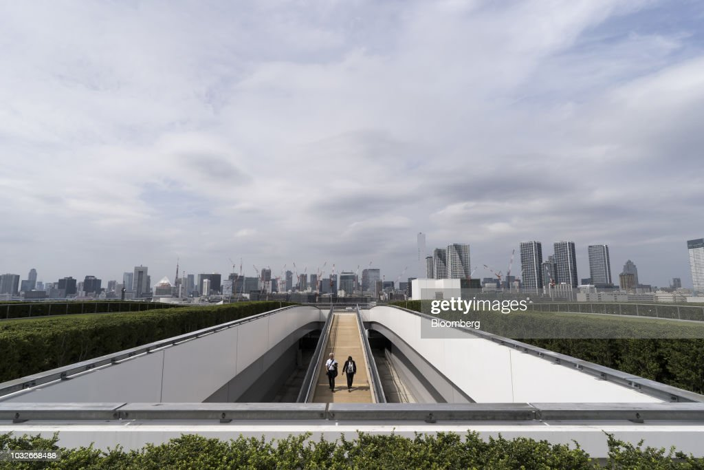 Members of the media walk through the rooftop garden at Toyosu Market in Tokyo, Japan, on Thursday, Sept. 13, 2018. The Toyosu Market, where the iconic Tsukiji fish market will relocate to, is scheduled to being operations on Oct. 11. Photographer: Tomohiro Ohsumi/Bloomberg via Getty Images