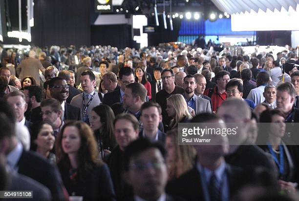 Members of the media walk to press conferences on Monday during the press preview for the 2016 North American International Auto Show at Cobo Hall on...