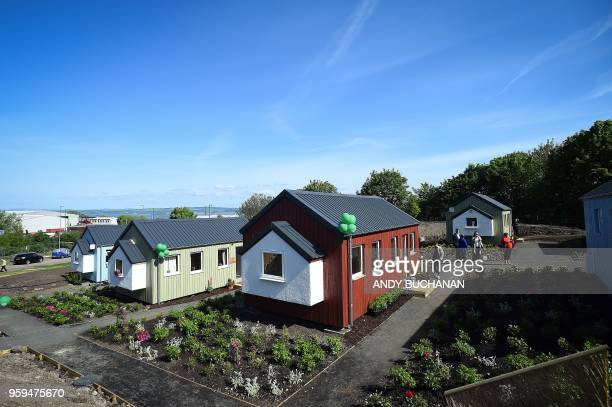 Members of the media wander among the NestHouses during the launch of the Social Bite Village project in Granton Edinburgh in Scotland on May 17 2018...