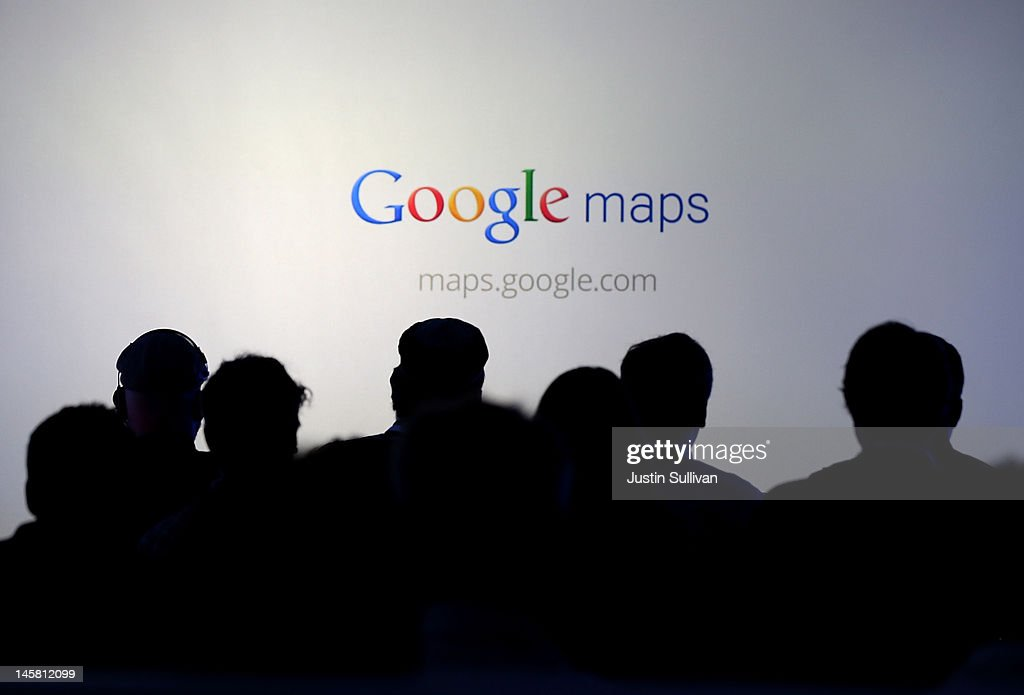 Members of the media watch a slideshow during a news conference about Google Maps on June 6, 2012 in San Francisco, California. Google announced new upgrades to Google maps including a feature to download maps and view offline, better 3D mapping and a backpack camera backpack camera device called Trekker that will allow Street View to go offroad on hiking trails and places only accessible by foot.