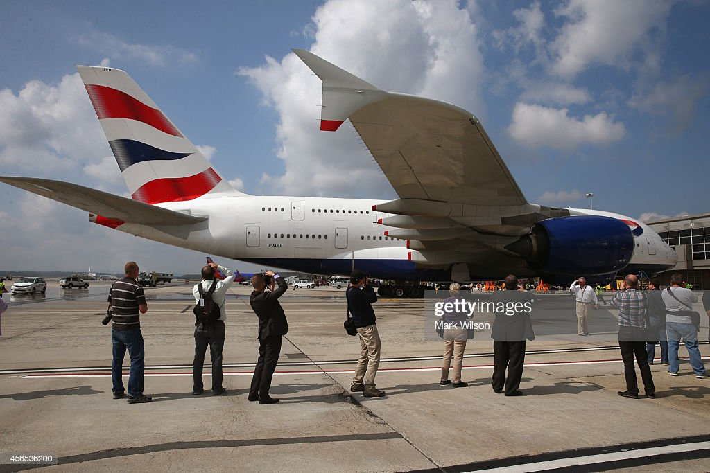 Members of the media watch as British Airways' new super jumbo Airbus A380 taxies to its gate at Washington Dulles International Airport October 2, 2014 in Dulles, Virginia. British Airways introduced the first Airbus A380 nonstop service between London Heathrow and Washington Dulles International Airport.