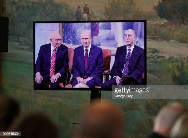 Members of the media watch as Russell M Nelson speaks via television from the historic Mormon Salt Lake Temple to members of the Church of Jesus...