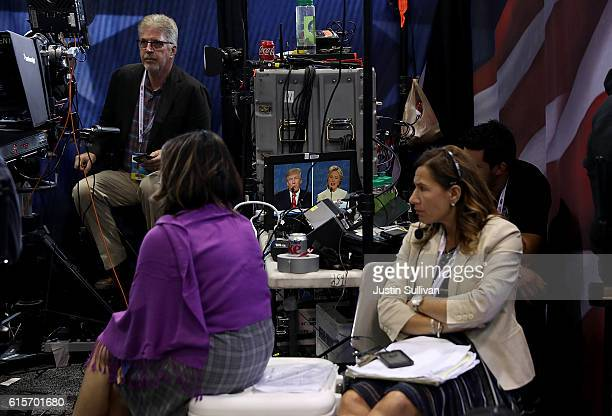 Members of the media watch the third US presidential debate with republican presidential nominee Donald Trump democratic presidential nominee former...