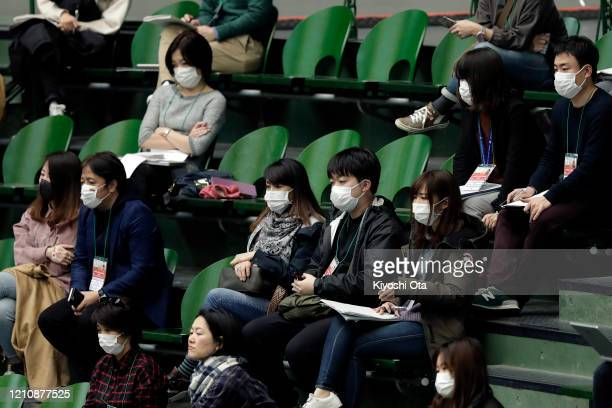 Members of the media wearing face masks are seen during the singles match between Yasutaka Uchiyama of Japan and Roberto Quiroz of Ecuador on day one...