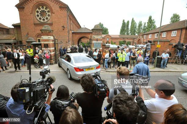 Members of the media with public gather outside Golders Green Crematorium for the private funeral service for singer Amy Winehouse