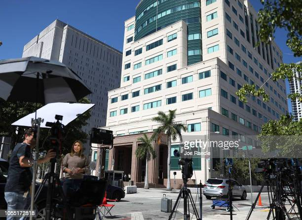 Members of the media work outside the Federal District court for the Southern District of Florida where Cesar Sayoc will be formally addressed with...