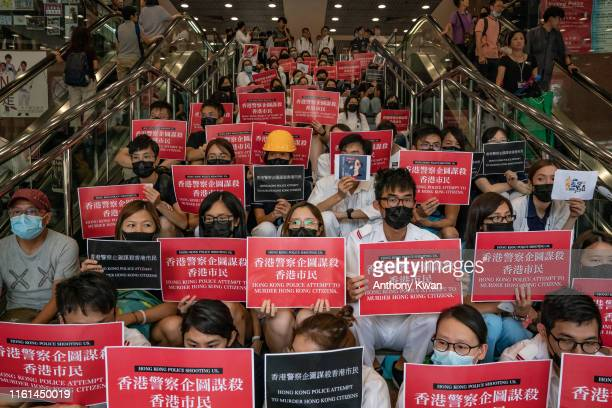 Members of the medical profession gather to protest against Hong Kong police brutality at Queen Elizabeth Hospital on August 13 2019 in Hong Kong...