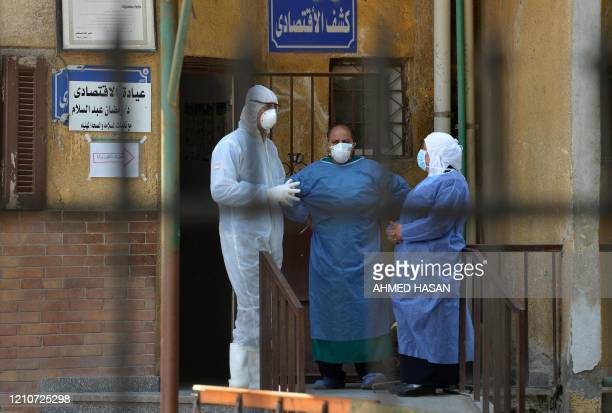 Members of the medical staff at the infectious diseases unit of the Imbaba hospital in the capital Cairo gather for a break on April 19 during the...