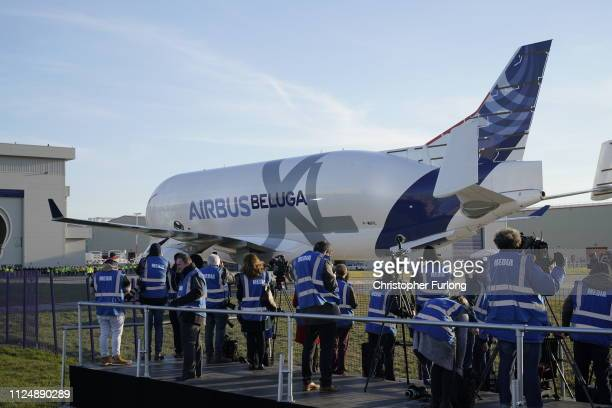 Members of the medis watch a new Airbus Beluga XL which is making its maiden flight to the UK land at Airbus Broughton wing assembly plant on...