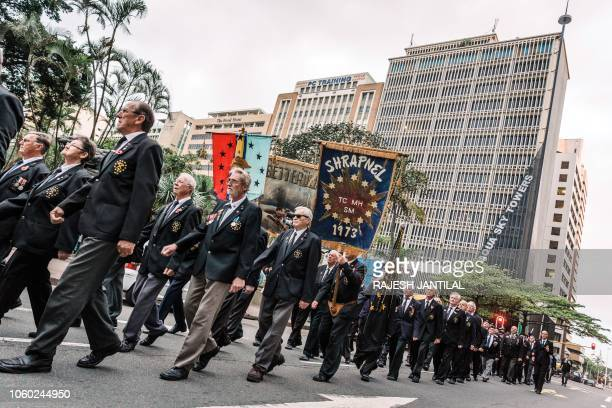 Members of the Memorable Order Of the Tin Hat take part in a Sunset Parade in Durban on November 11 2018 as part of commemorations marking the 100th...