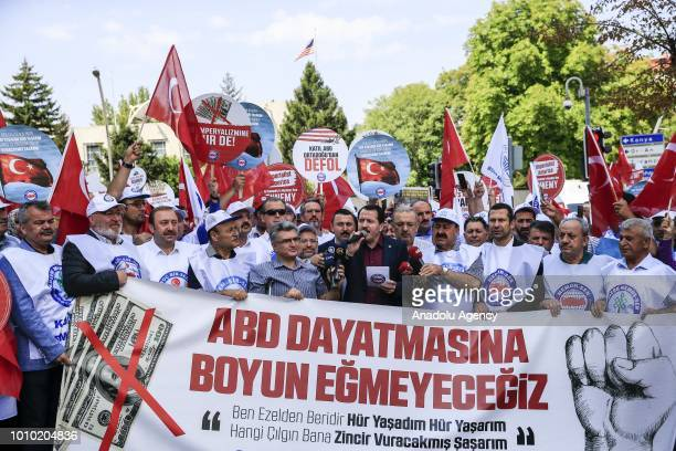 Members of the MemurSen protest against the US sanctions on two Turkish ministers outside the US Embassy in Ankara Turkey on August 03 2018 On...