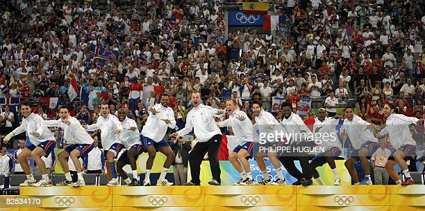 Members of the men's handball team of France joke on the podium before receiving the gold medal of the 2008 Beijing Olympic Games on August 24, 2008...