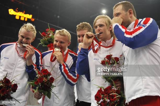Members of the men's handball team of Iceland pose on the podium after receiving the silver medal of the 2008 Beijing Olympic Games on August 24,...