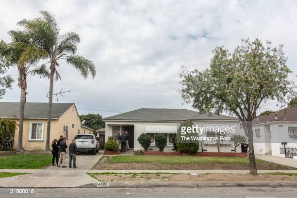 Members of the Mental Evaluation Team wait outside of the home of a veteran who expressed signs of paranoia and called the police over the weekend...