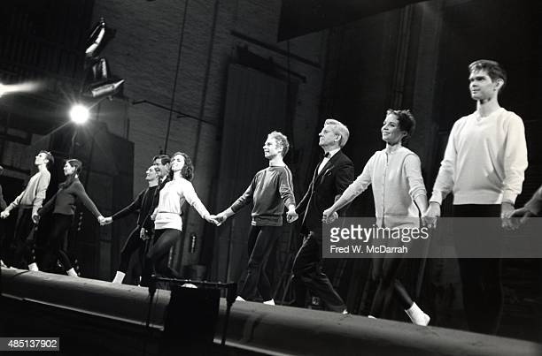 American dancer and choreographer Merce Cunningham and members of his dance company take a bow following a performance at the State University of New...