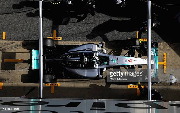 Members of the Mercedes GP team surround the car with screens as Nico Rosberg of Germany and Mercedes GP returns to the garage during day two of F1...