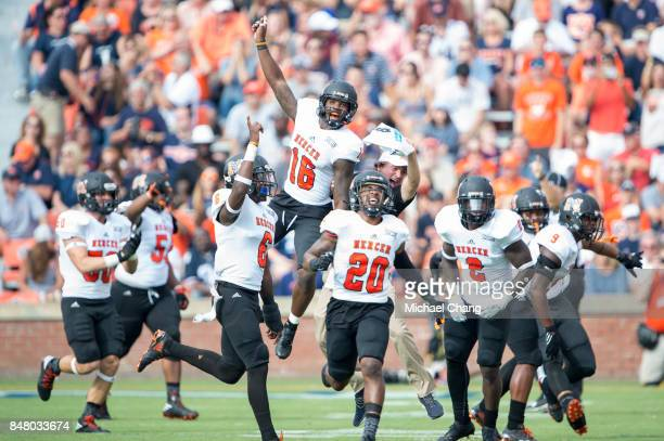 Members of the Mercer Bears celebrate after recovering a fumble during their game against the Auburn Tigers at JordanHare Stadium on September 16...