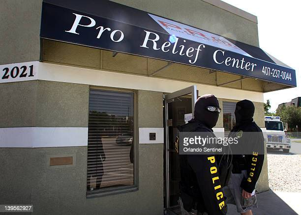 Members of the Metropolitan Bureau of Investigation stand outside of Pain Relief Orlando near downtown Orlando June 3 2011 Drug agents have called...