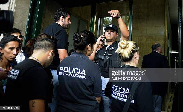 Members of the Metropolitan Police arrive to make a raid at the offices of Argentine prosecutor Alberto Nisman in Buenos Aires on January 20 2015 two...
