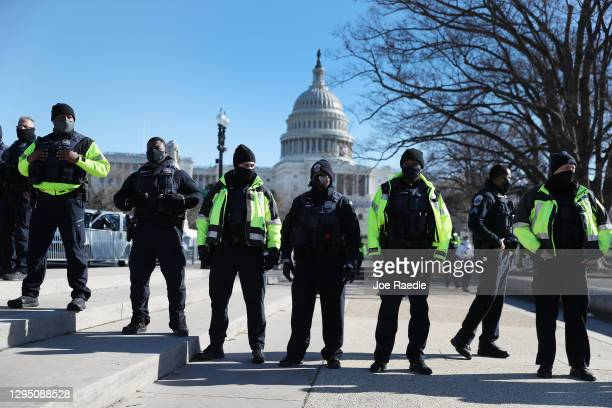 Members of the Metropolitan Police Department of the District of Columbia are seen in front of the U.S. Capitol a day after a pro-Trump mob broke...