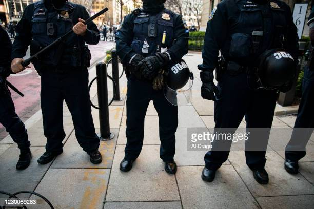 Members of the Metropolitan Police Department stand guard as they separate counter-protesters from supporters of President Trump near Black Lives...