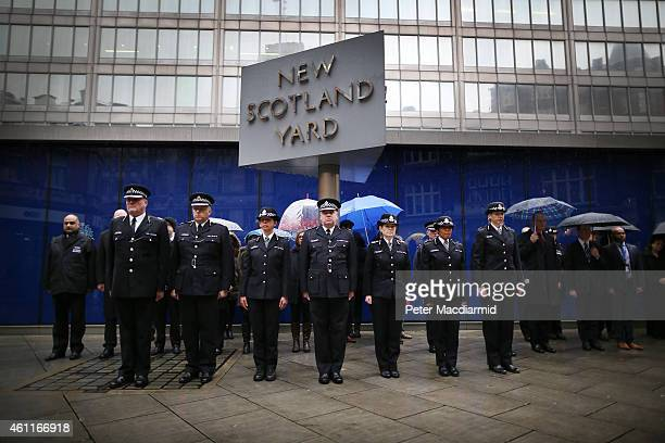 Members of the Metropolitan Police Service observe two minutes silence at new Scotland Yard on January 8, 2015 in London, England. France is on...