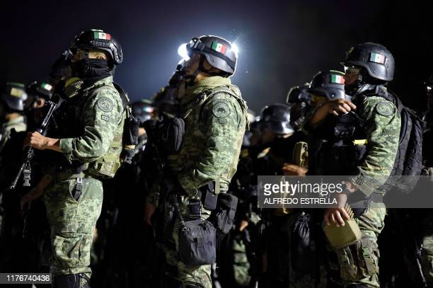 Members of the Mexican Army Special Forces arrive to the Airport of Culiacan Sinaloa state Mexico on October 18 2019 Mexico's president faced a...