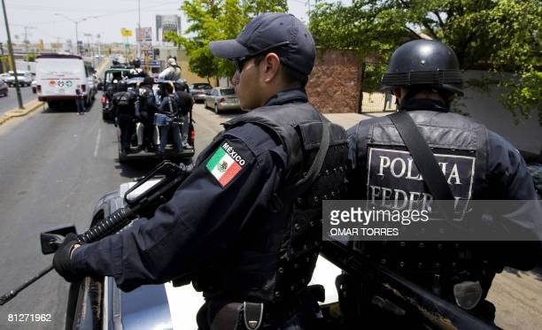 Members of the Mexican Federal Police arrive to patrol the city of Culiacan to reinforce the surveillance operation against drug trafficking in...