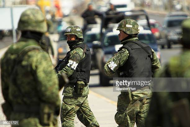 Members of the Mexican military police keep guard at the scene of the murder of two women aged 17 and 21 March 24 2010 in Juarez Mexico Secretary of...