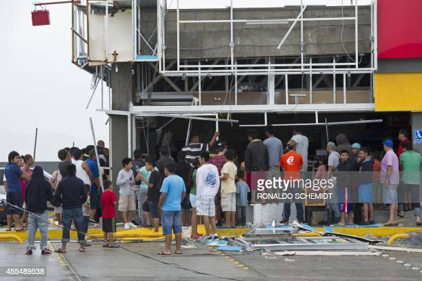 Members of the Mexican Navy keep looters at bay at supermarket damaged by hurricane Odile in Cabo San Lucas in Mexico's Baja California peninsula on...