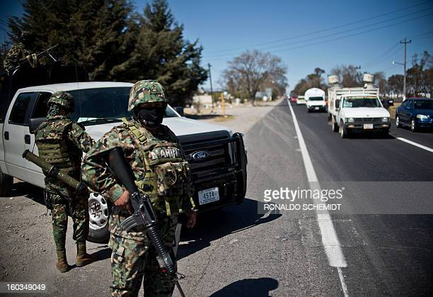 Members of the Mexican Navy patrol a highway in the state of Mexico near the capital Toluca on January 29 2013 According to local authorities000...
