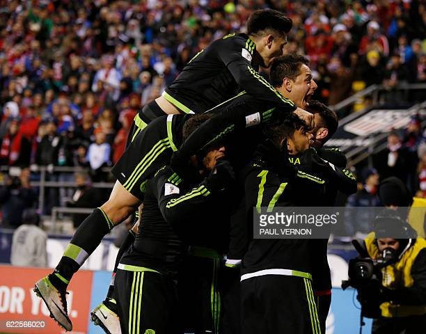 Members of the Mexico men's national team celebrate Rafael Marquez's goal against the US men's national team during the 2018 FIFA World Cup...