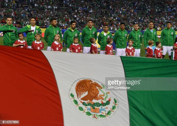 Members of the Mexico team sing their national anthem before their Group C game against Jamaica during the 2017 CONCACAF Gold Cup at the Sports...