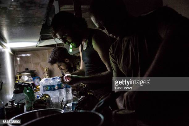 Members of the MFS cook dinner in their nocter on August 16 2017 on the front lines of western Raqqa The MFS is a group of Assyrian Christians who...