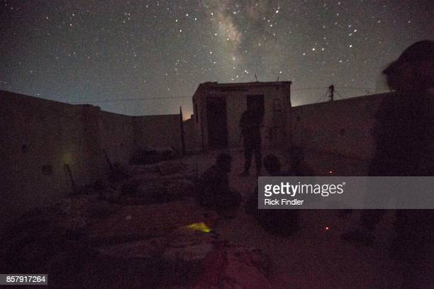 Members of the MFS sit in the dark as they man their nocter and hold the front line preventing ISIS from being able to break out of the squeeze which...