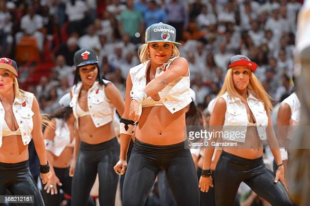 Members of the Miami Heat Dance Team get the crowd pumped up against the Chicago Bulls in Game One of the Eastern Conference Semifinals during the...
