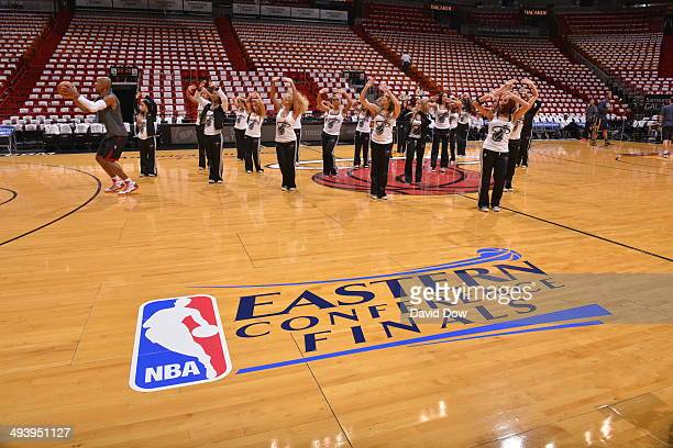 Members of the Miami Heat Dance Team warmsup prior to the game against the Indiana Pacers during Game Four of the Eastern Conference Finals on May 26...