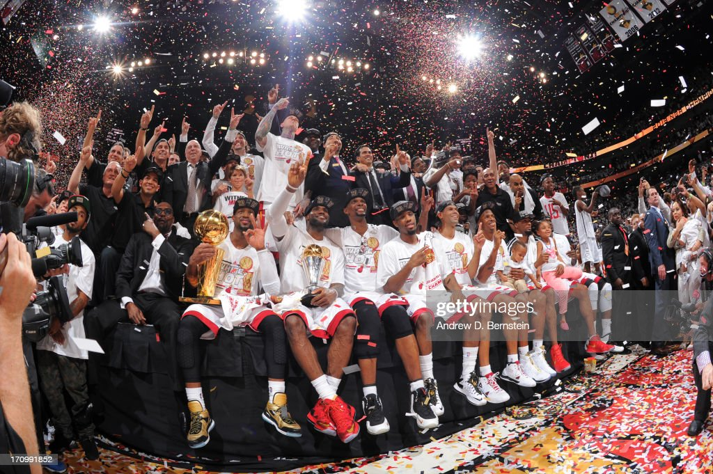 Members of the Miami Heat pose for a photo after defeating the San Antonio Spurs in Game Seven of the 2013 NBA Finals on June 20, 2013 at the American Airlines Arena in Miami, Florida.
