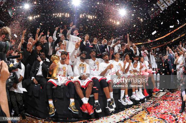 Members of the Miami Heat pose for a photo after defeating the San Antonio Spurs in Game Seven of the 2013 NBA Finals on June 20 2013 at the American...