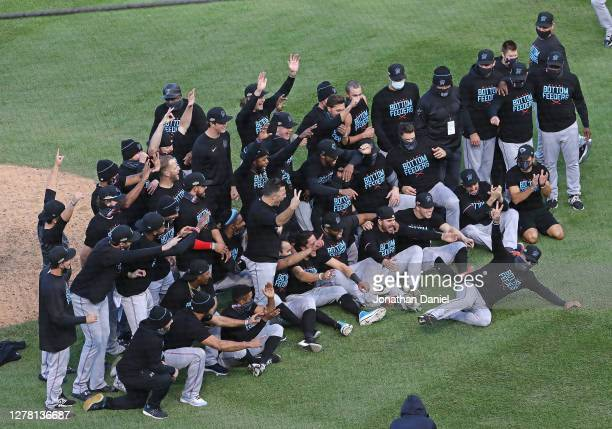 Members of the Miami Marlins celebrate a win over the Chicago Cubs during Game Two of the National League Wild Card Series at Wrigley Field on...